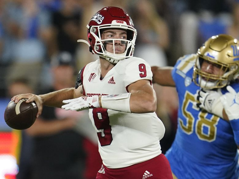 Fresno State quarterback Jake Haener looks for a receiver during the first half of the team's NCAA college football game against UCLA on Saturday, Sept. 18, 2021, in Pasadena, Calif. (Marcio Jose Sanchez / The Associated Press)