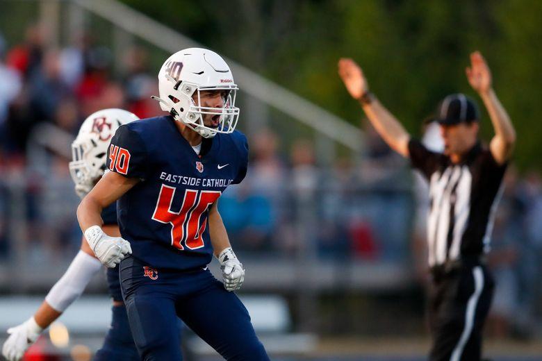 Eastside Catholic's Dallas Sooto celebrates a touchdown during last week's win over Kennedy Catholic. (Jennifer Buchanan / The Seattle Times)