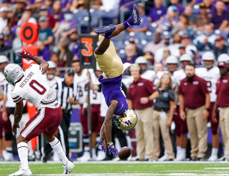 Washington Huskies wide receiver Giles Jackson gets upended by Montana Grizzlies cornerback Omar Hicks Onu on third down forcing a punt during the second quarter, Sept. 4, 2021, in Seattle. (Jennifer Buchanan / The Seattle Times)