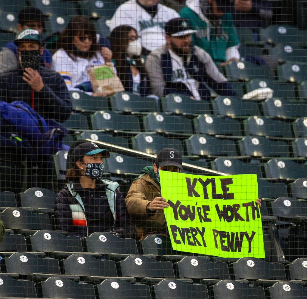 Fans along the thrid baseline have an opinion on Kyle Seager's coming contract negotiation, April 6, 2021 in Seattle. (Dean Rutz / The Seattle Times)