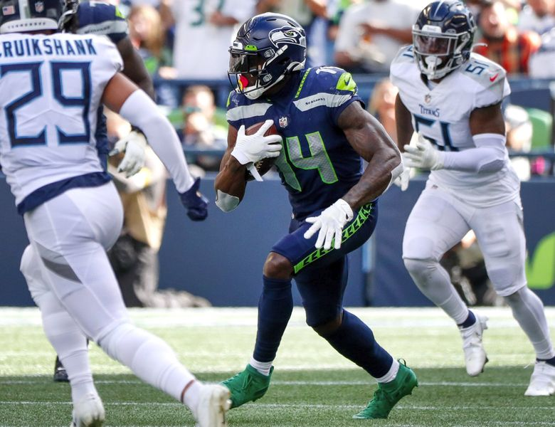 Seattle Seahawks wide receiver DK Metcalf picks up yards after a catch during the third quarter Sept. 19, 2021, in Seattle. (Jennifer Buchanan / The Seattle Times)