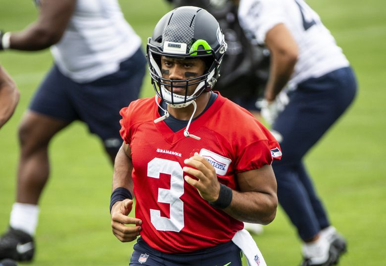 Russell Wilson warms up during practice at the Virginia Mason Athletic Center on Thursday, Sept. 9, 2021. (Amanda Snyder / The Seattle Times)