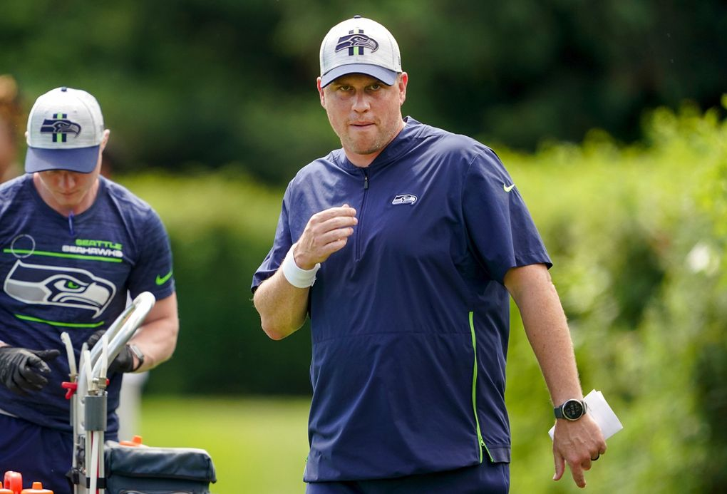 Seattle Seahawks offensive coordinator Shane Waldron, right, takes part in NFL football practice Wednesday, July 28, 2021, in Renton, Wash. (Ted S. Warren / The Associated Press)