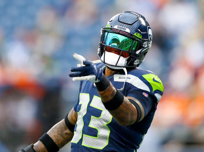 Lumen Field is reflected in the visor of Seattle Seahawks safety Jamal Adams before the start of a preseason game against the Denver Broncos Saturday, Aug. 21, in Seattle. (Jennifer Buchanan / The Seattle Times)
