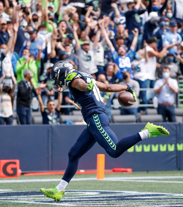 Seattle Seahawks wide receiver Tyler Lockett runs down the field for a touchdown dagainst the Tennessee Titans, Sept. 19, 2021, in Seattle. (Jennifer Buchanan / The Seattle Times)