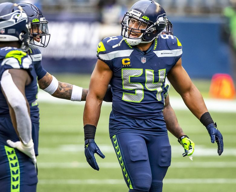 Seahawks middle linebacker Bobby Wagner, right, was selected a first team All-Pro for the sixth time in 2020. (Bettina Hansen / The Seattle Times)
