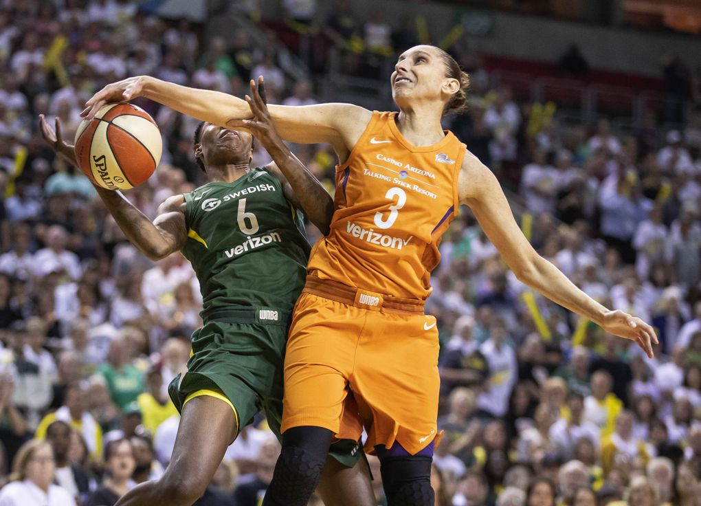 Phoenix guard Diana Taurasi puts a hard foul on Seattle's Natasha Howard in the 1st quarter. The Phoenix Mercury played the Seattle Storm in the second game of the best-of-five WNBA Semifinals Tuesday, August 28, 2018 at KeyArena in Seattle.  (Dean Rutz / The Seattle Times)