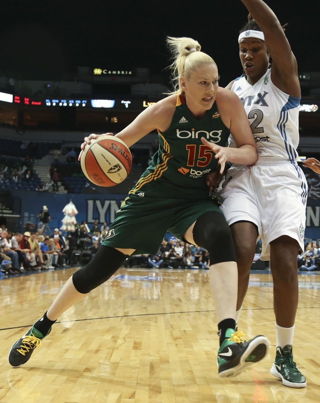 Rebekkah Brunson of the Minnesota Lynx tries to blocked the path of the Seattle Storm's Lauren Jackson, left, during the first quarter on Tuesday, October 2, 2012, at the Target Center in Minneapolis, Minnesota, in Game 3 of their playoff series. (Kyndell Harkness / McClatchy Newspapers)
