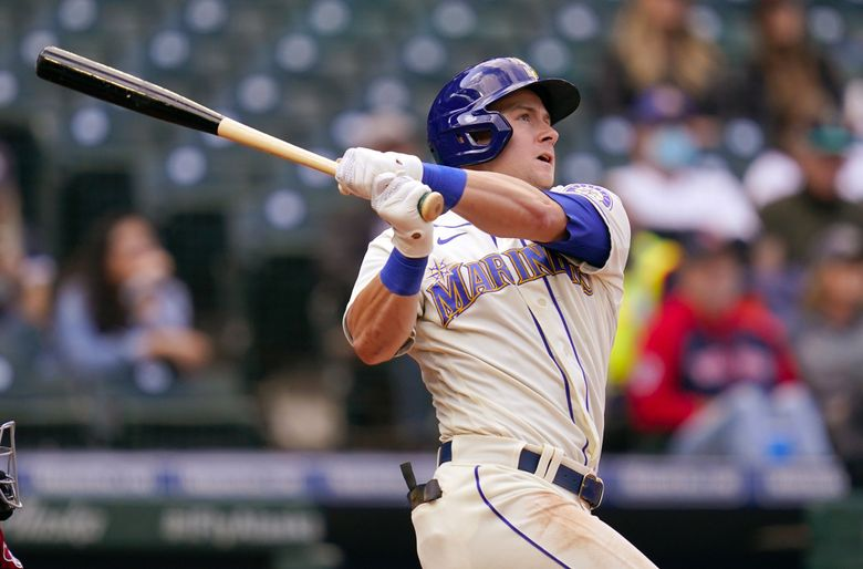 Seattle Mariners' Jarred Kelenic watches the path of his two-run home run against the Arizona Diamondbacks in the ninth inning of a baseball game Sunday, Sept. 12, 2021, in Seattle.  (Elaine Thompson / The Associated Press)