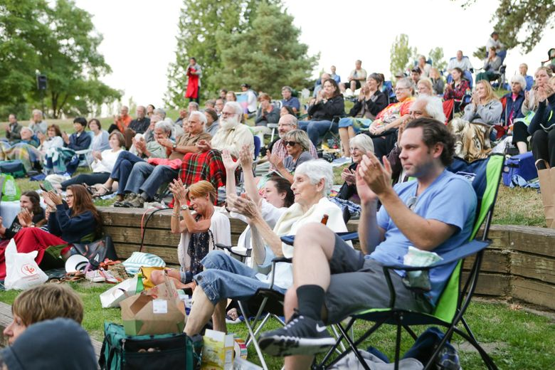 """At Seattle Shakespeare Company's Wooden O series, audience members are accustomed to picnicking among a crowd of viewers. In 2021, said frequent attendee Rick Edwards, the tradition felt different. Shown here is the audience for Wooden O's """"As You Like It"""" in 2015. (Courtesy of  Seattle Shakespeare Company)"""