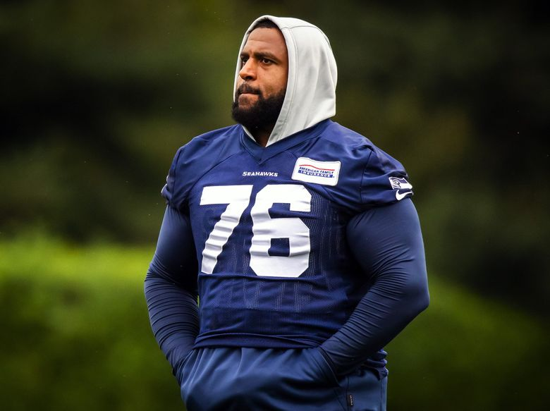 Seahawks offensive tackle Duane Brown walks off the field after Seahawks Training Camp at the Virginia Mason Athletic Center in Renton Saturday July 31, 2021. (Bettina Hansen / The Seattle Times)