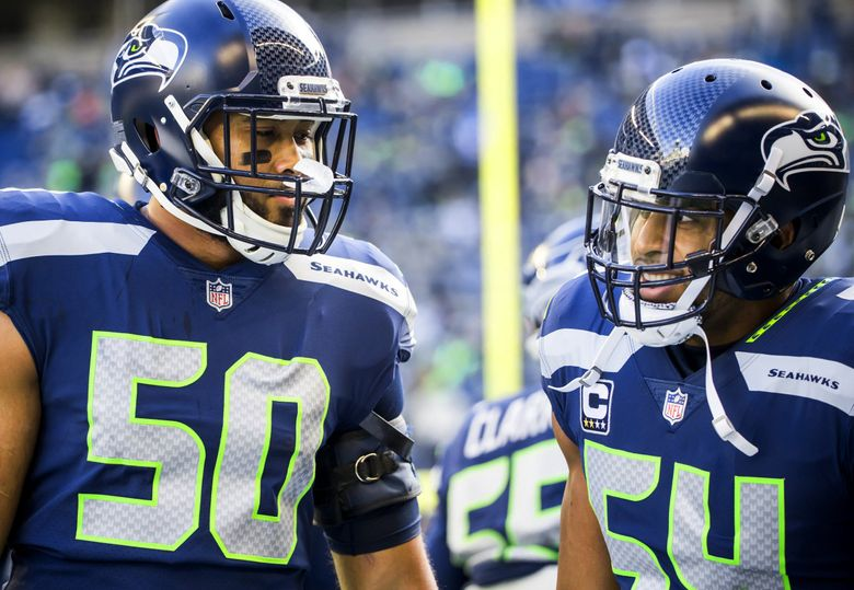 Seahawks linebackers K.J. Wright and Bobby Wagner talk before the Seattle Seahawks take on the Arizona Cardinals at CenturyLink Field in Seattle, Sunday December 31, 2017. (Bettina Hansen / The Seattle Times)
