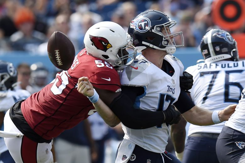 Arizona Cardinals linebacker Chandler Jones sacks Tennessee Titans quarterback Ryan Tannehill and forces a fumble that the Cardinals recovered in the second half during their game Sunday. (Mark Zaleski / AP)