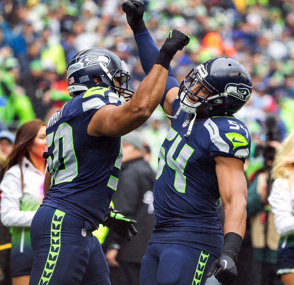 Linebackers K.J. Wright and Bobby Wagner greet each other during introductions before the Seattle Seahawks defeat the Atlanta Falcons 26-24 at CenturyLink Field in Seattle Sunday October 16, 2016. (Bettina Hansen / The Seattle Times)