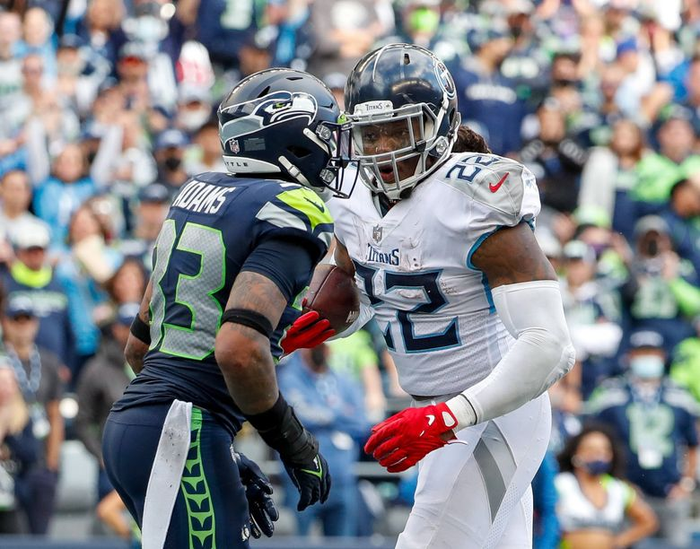 Tennessee Titans running back Derrick Henry looks at Seattle Seahawks safety Jamal Adams after scoring the game tying touch down during the fourth quarter Sept. 19, 2021, in Seattle. (Jennifer Buchanan / The Seattle Times)