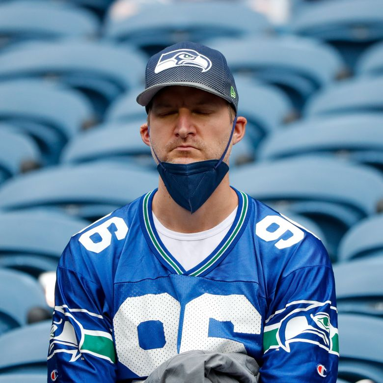 An unhappy fan sits in the stands after the Seahawks lost to the Titans in overtime Sept. 19, 2021, in Seattle. (Jennifer Buchanan / The Seattle Times)