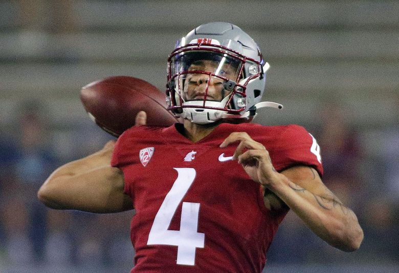 Washington State quarterback Jayden de Laura throws a pass during the second half of an NCAA college football game against Utah State on Saturday, Wash. (Young Kwak / The Associated Press)