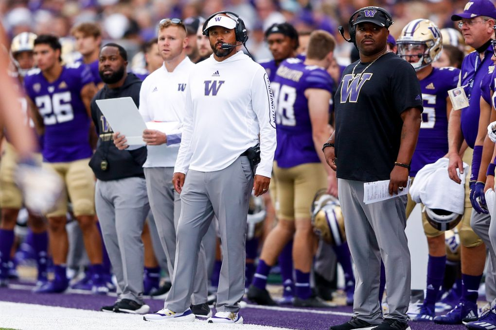 Washington Huskies head coach Jimmy Lake stands on the sidelines during the second quarter against the Montana Grizzlies Saturday, Sept. 4, in Seattle. (Jennifer Buchanan / The Seattle Times)