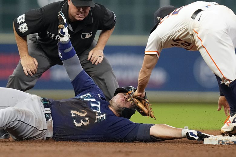 Seattle Mariners' Ty France (23) is tagged out by Houston Astros second baseman Jose Altuve (27) while trying to stretch a single into a double during the sixth inning of a baseball game Monday, Sept. 6, 2021, in Houston. (David J. Phillip / The Associated Press)