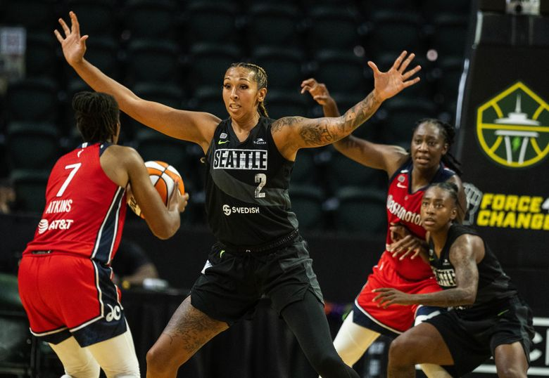 Seattle's Mercedes Russell tries to cut off the passing lane for Washington's Ariel Atkins in the 4th quarter.  The Washington Mystics played the Seattle Storm in WNBA action Tuesday, June 22, 2021 at Angel of the Winds Arena in Everett, WA. 217469 (Dean Rutz / The Seattle Times)