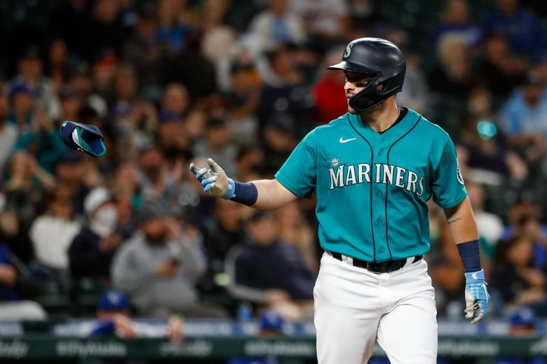 The Mariners' Luis Torrens tosses his elbow protector after drawing a bases-loaded walk to score J.P. Crawford  during the second inning against the  Royals last month. (Jennifer Buchanan / The Seattle Times)