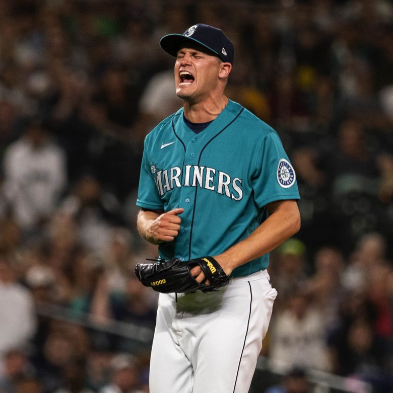 Paul Sewald reacts to getting Oakland's Elvis Andrus to strike out with the bases loaded to retire the side in the 7th inning Friday, July 23, at T-Mobile Park in Seattle. (Dean Rutz / The Seattle Times)