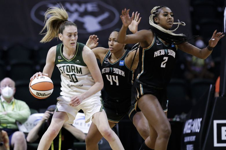 Seattle Storm forward Breanna Stewart (30) is defended by New York Liberty's Betnijah Laney (44) and DiDi Richards (2) in the second half of a game on Sept. 2 in Everett.  (Jason Redmond / Special to The Seattle Times)