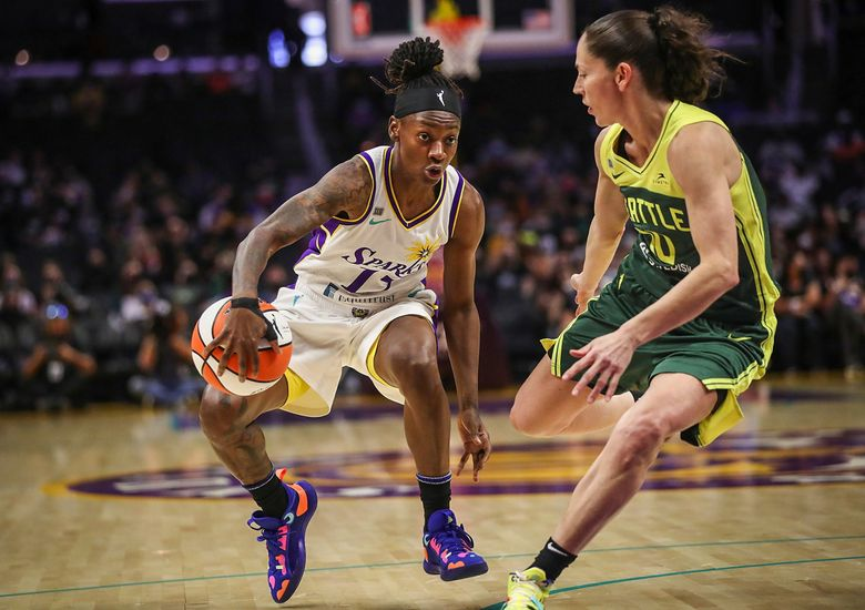 Guard Erica Wheeler of the Los Angeles Sparks handles the ball defended by guard Sue Bird, right, of the Seattle Storm in the first half (Meg Oliphant / Getty Images)