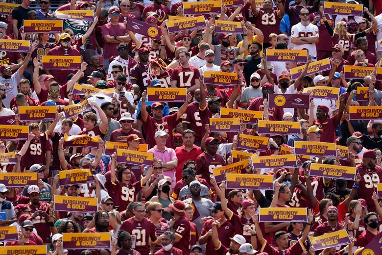 "Washington Football Team fans cheered for the ""Burgundy & Gold"" — while dodging some brown? (Alex Brandon / AP)"
