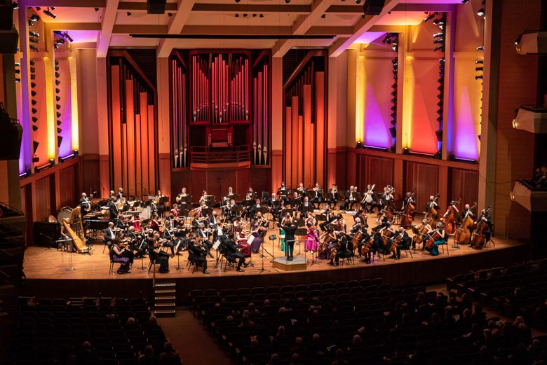The Seattle Symphony Orchestra performs during opening night of its 2021-22 season, led by the dynamic Xian Zhang. (James Holt / Seattle Symphony)