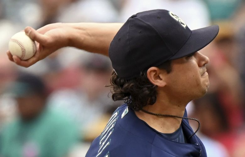 Seattle Mariners pitcher Marco Gonzales throws to home plate during the first inning of a baseball game against the Los Angeles Angels, Sunday, Sept. 26, 2021, in Anaheim, Calif.