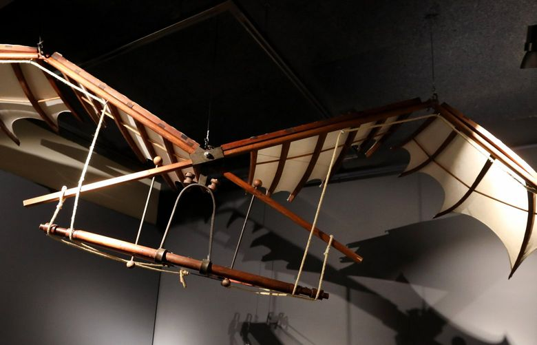 Da Vinci was fascinated by the possibility of human theft.  This representation of a flying machine flapped its wings and the pilot lay flat in it.  exhibit at MOHAI Friday July 23, 2021 217700