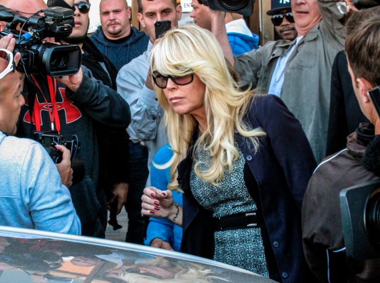 FILE – In this Sept. 24, 2013 file photo, Dina Lohan leaves court in Hempstead, N.Y., after pleading not guilty to drunken driving charges. Lohan pleaded guilty to drunken driving on Tuesday, Sept. 28, 2021, and is expected to be sentenced to 18 days in jail and five years' probation for rear-ending another car on Long Island and leaving the scene. (AP Photo/Frank Eltman, File)