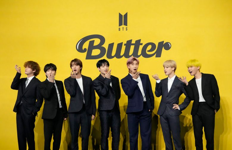 """FILE – In this May 21, 2021, file photo members of South Korean K-pop band BTS pose for photographers ahead of a press conference to introduce their new single """"Butter"""" in Seoul, South Korea. Chinese social media platform Weibo has banned a fan club of popular South Korean K-pop band BTS from posting for 60 days. Weibo said Sunday, Sept. 5, 2021, the club had raised funds illegally. The ban comes just days after photographs of a customized airplane funded by the fan club were posted online. (AP Photo/Lee Jin-man, File)"""