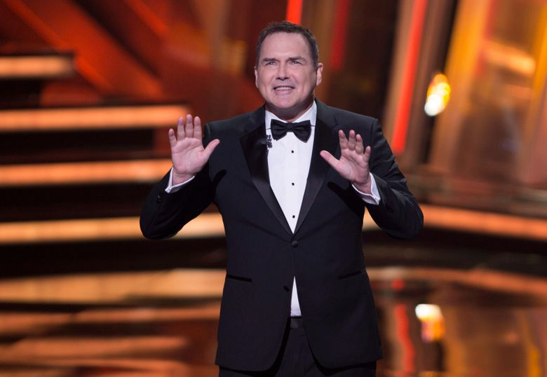 """FILE – Norm Macdonald hosts the Canadian Screen Awards in Toronto on March 13, 2016. Macdonald, a comedian and former cast member on """"Saturday Night Live,"""" died Tuesday, Sept. 14, 2021, after a nine-year battle with cancer that he kept private, according to Brillstein Entertainment Partners, his management firm in Los Angeles. He was 61. (Peter Power/The Canadian Press via AP, File)"""