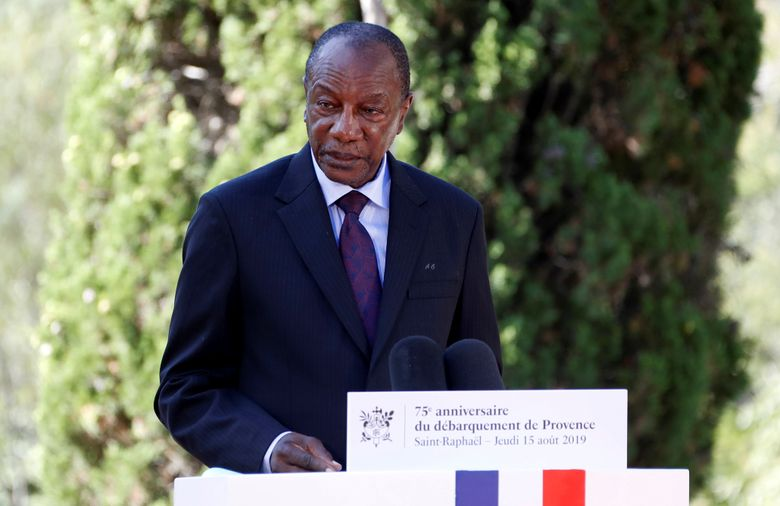 FILE – In this Thursday, Aug. 15, 2019 file photo, Guinean President Alpha Conde delivers a speech during a ceremony marking the 75th anniversary of the WWII Allied landings in Provence, in Saint-Raphael, southern France. Witnesses say heavy gunfire has erupted near the presidential palace in Guinea's capital and went on for hours. It was not immediately known whether President Alpha Conde was home at the time the shooting began. But the gunfire prompted security concerns in the West African country with a long history of coup attempts.  (Eric Gaillard/Pool Photo via AP, File)