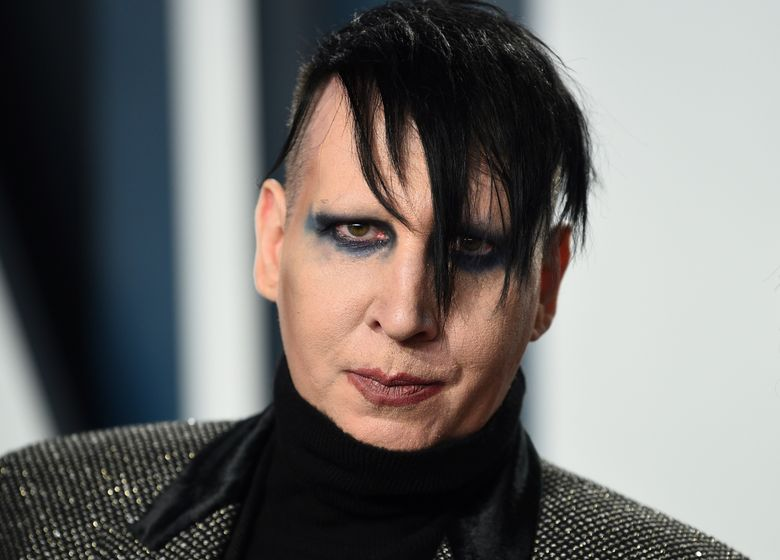 FILE – Marilyn Manson arrives at the Vanity Fair Oscar Party on Feb. 9, 2020, in Beverly Hills, Calif. An attorney has entered a not guilty plea on behalf Manson, who is accused of approaching a videographer at his 2019 concert in New Hampshire and allegedly spitting and blowing his nose on her. A case status hearing is scheduled for Dec. 27. (Photo by Evan Agostini/Invision/AP, File)