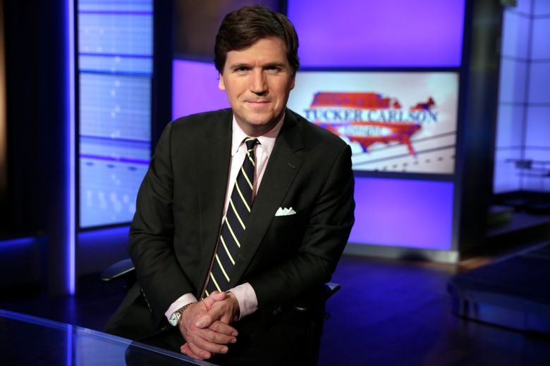 """FILE – In this March 2, 20217, file photo, Tucker Carlson, host of """"Tucker Carlson Tonight,"""" poses for photos in a Fox News Channel studio in New York. A steady criticism of COVID vaccine mandates by figures on Fox News has drawn attention to its own company's stringent rules on the topic — even from President Joe Biden. Carlson devoted nearly the first 20 minutes of his show on Sept. 15, 2020, to Biden's COVID efforts, saying the rules require people to submit to being bullied. (AP Photo/Richard Drew, File)"""