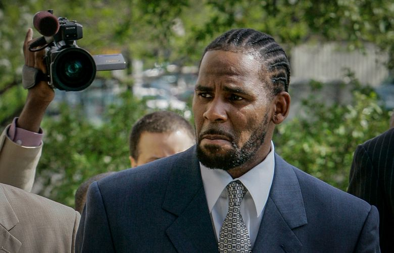 FILE – This photo from Friday May 9, 2008, shows R. Kelly arriving for the first day of jury selection in his child pornography trial at the Cook County Criminal Courthouse in Chicago. On Wednesday, Sept. 15, 2021, prosecutors in Kelly's sex trafficking trial at Brooklyn Federal Court in New York, played video and audio recordings for the jury they say back up allegations he abused women and girls. (AP Photo/Charles Rex Arbogast, File)