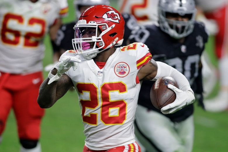 FILE – In this Nov. 22, 2020, file photo, Kansas City Chiefs running back Le'Veon Bell (26) carries the ball against the Las Vegas Raiders during the first half of an NFL football game in Las Vegas. The Baltimore Ravens signed Bell to their practice squad, adding another backfield option in the aftermath of J.K. Dobbins' season-ending injury. Bell was cut early last season by the New York Jets, then rushed for 328 yards in 11 games with Kansas City. He did not play in the Super Bowl for the Chiefs. (AP Photo/Isaac Brekken, File)