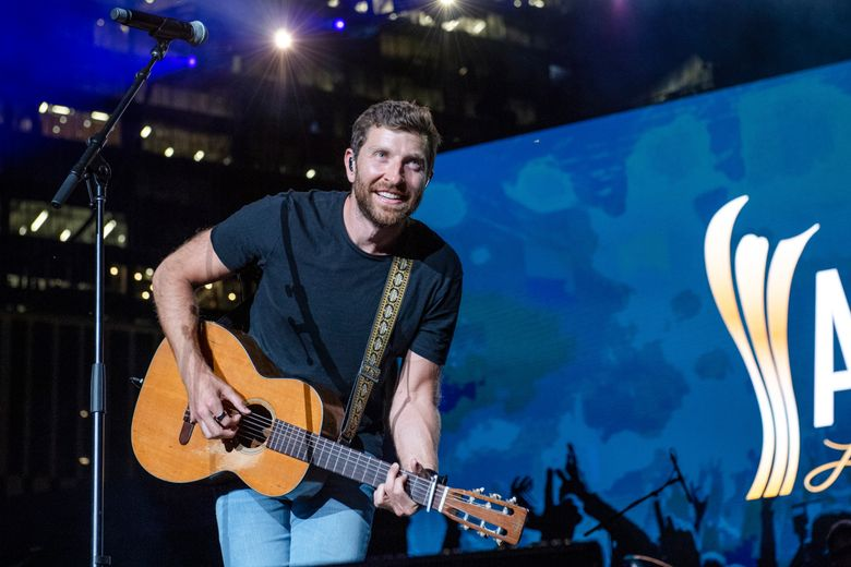 FILE – In this Tuesday, August 24, 2021, file photo, Brett Eldredge performs at the 2021 ACM Party for a Cause at Ascend Amphitheater, in Nashville, Tenn. Country singer Eldredge has had another encounter with wildlife, this one involving a bear at a North Carolina home. This week, Eldredge posted a video of the run-in after the bear entered a garage at a home in Asheville, N.C., as he was about to go on a hike, The Charlotte Observer reported. (Photo by Amy Harris/Invision/AP, File)