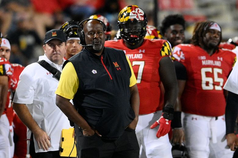 Maryland head coach Michael Locksley, foreground, watches from the sideline during the second half of an NCAA college football game against Howard, Saturday, Sept. 11, 2021, in College Park, Md. (AP Photo/Nick Wass)