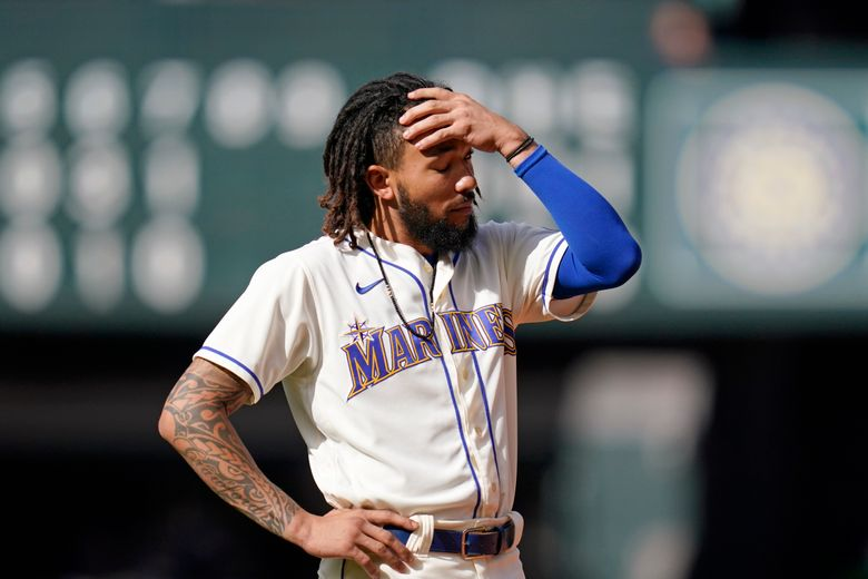 Seattle Mariners' J.P. Crawford stands on the field after he flew out to end the seventh inning against the Arizona Diamondbacks on Sunday. (AP Photo/Elaine Thompson)