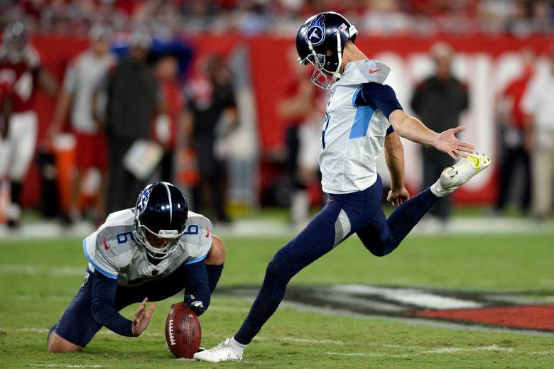 FILE – In this Aug 21, 2021, file photo, Tennessee Titans' Sam Ficken, right, boots a field goal against the Tampa Bay Buccaneers as punter Brett Kern (6) holds during the first half of an NFL preseason football game in Tampa, Fla. Ficken has been added to the injury report with an injured groin and the Titans have signed Michael Badgley to the practice squad. Tennessee opens the season Sunday, Sept. 12, 2021, hosting Arizona. (AP Photo/Jason Behnken, File)