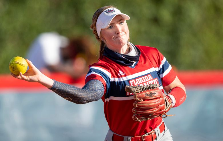 This Feb. 20, 2021 photo shows FAU utility player Riley Ennis during an NCAA softball game in Boca Raton, Fla.  All women's athletes at Florida Atlantic were invited Wednesday, Sept. 8, 2021 to sign endorsement deals with the NHL's Florida Panthers, the first such offer made by a U.S. major pro franchise. (AP Photo/Doug Murray, File)