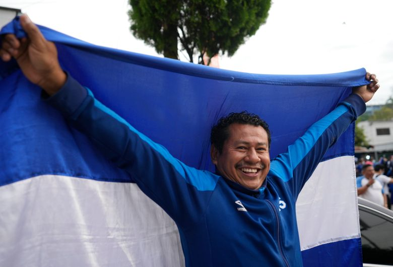An El Salvador fan cheers prior a qualifying soccer match against United States for the FIFA World Cup Qatar 2022 at Cuscatlan stadium in San Salvador, El Salvador, Thursday, Sept. 2, 2021. (AP Photo/Moises Castillo)
