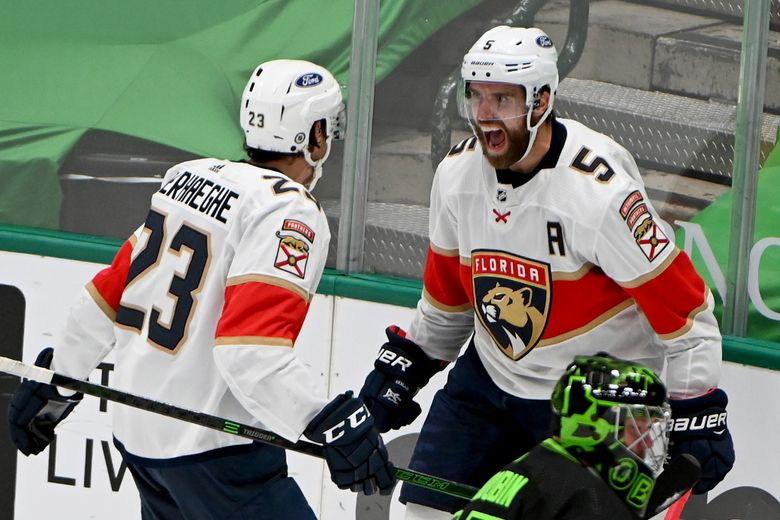 FILE – Florida Panthers defenseman Aaron Ekblad (5) and Florida Panthers center Carter Verhaeghe (23) celebrate Ekblad's winning goal as Dallas Stars goaltender Anton Khudobin, lower right, looks on during the overtime period of an NHL hockey game in Dallas, in this Saturday, March 27, 2021, file photo. The Florida Panthers won in overtime, 4-3. Ekblad, who broke his left leg midway through last season, says he will be full-go when the Panthers open training camp Thursday, Sept. 23. (AP Photo/Matt Strasen, File)