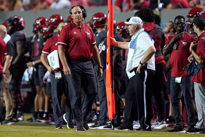 North Carolina State head coach Dave Doeren looks on during the second half of an NCAA college football game against South Florida in Raleigh, N.C., Thursday, Sept. 2, 2021. (AP Photo/Gerry Broome)