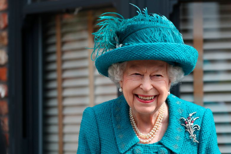 FILE – In this Thursday July 8, 2021 file photo, Britain's Queen Elizabeth visits the set of the long running television series Coronation Street, in Manchester, England.  Queen Elizabeth II and the Royal Family back the Black Lives Matter movement, one of her senior representatives has said in a television interview to be broadcast later Friday, Sept. 10. (AP Photo/Scott Heppell, file)