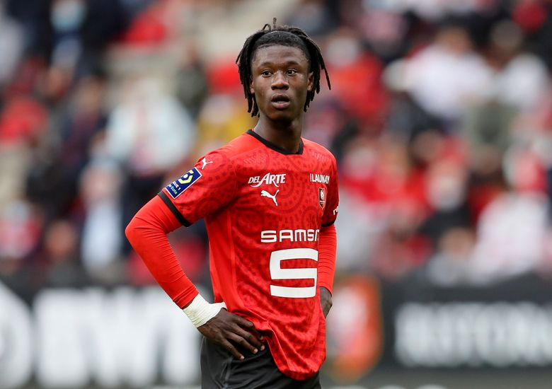 """FILE – In this Saturday, Aug. 29, 2020 file photo, Rennes' Eduardo Camavinga looks on during their League One soccer match against Montpellier, at the Roazhon Park stadium in Rennes, France. Spain's state television has on Friday, Sept. 10, 2021 condemned and apologized for a racist comment made by a guest sports commentator during the presentation of Real Madrid player Eduardo Camavinga. Analyst Lorena Gonzalez was heard off-camera saying """"this guy is blacker than his suit"""" during Camavinga's presentation this week. (AP Photo/David Vincent, File)"""